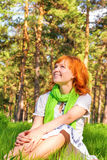 Happy woman in sunny park Stock Images