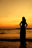 Happy Woman in Sunset at beach in  Thailand Stock Photo