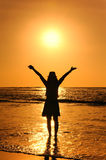 Happy Woman in Sunset at beach in  Thailand Royalty Free Stock Photos