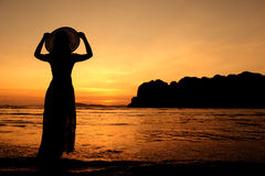 Happy Woman in Sunset at beach in  Thailand Stock Images