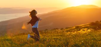Happy woman   on sunset in nature iwith open hands Stock Image
