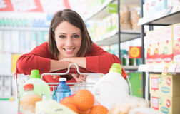 Happy woman at the supermarket Stock Image