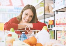 Happy woman at the supermarket royalty free stock photo