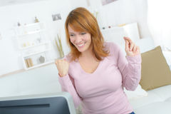 Happy woman surfing on internet Stock Photos