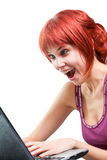 Happy woman surfing internet on laptop Stock Photography