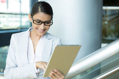 Happy woman surfing internet on tablet Royalty Free Stock Photography