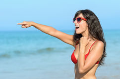 Happy woman surprised on summer beach Stock Image