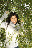 Happy woman surronded by a birch tree Royalty Free Stock Photography