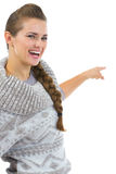 Happy woman in sweater pointing on copy space Royalty Free Stock Images