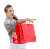 Happy woman in sweater with shopping bags Stock Images
