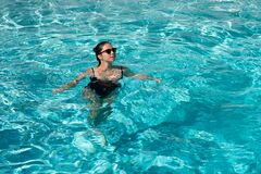 Happy woman in swimming pool. Summer weekend. Summertime vacation. Pool party. Summer resort.