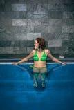 Happy woman in swimming pool Stock Photo