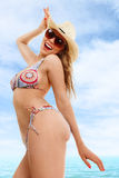 Happy woman in swimsuit. Happy blonde woman in swimsuit against sea water Stock Photography