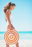 Happy woman in swimsuit with beach hat at seaside Royalty Free Stock Image