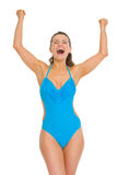 Happy woman in swimsuit and hat rejoicing success Royalty Free Stock Photo
