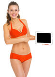 Happy woman in swimsuit pointing on tablet pc Royalty Free Stock Photography