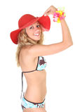 Happy woman in swimsuit with red hat Stock Photos