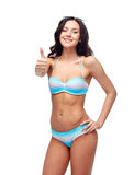 Happy woman in swimsuit showing thumbs up Stock Photography