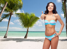 Happy woman in swimsuit showing thumbs up Royalty Free Stock Photo
