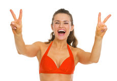 Happy woman in swimsuit showing victory gesture Stock Image