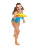 Happy woman in swimsuit throwing flying disc Stock Images