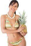 Happy woman in swimwear holding a pineapple Royalty Free Stock Images