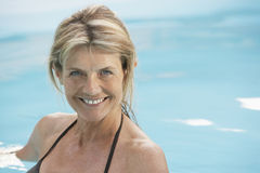Happy Woman In Swimwear Swimming In Pool royalty free stock image