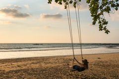 Happy woman on the swing and enjoy the freedom of summer on the Royalty Free Stock Images