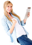 Happy woman with a tablet computer Royalty Free Stock Photos