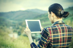 Happy woman with tablet pc Stock Images