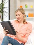 Happy woman with tablet pc computer Stock Images