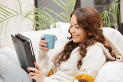 Happy woman with tablet pc computer Royalty Free Stock Image