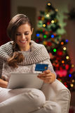 Happy woman with tablet PC and credit card Stock Photos