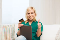 Happy woman with tablet pc and credit card Stock Images