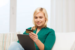 Happy woman with tablet pc and credit card Royalty Free Stock Photo