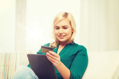 Happy woman with tablet pc and credit card Stock Photography