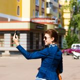 Happy woman take a selfie photo in the city. royalty free stock image