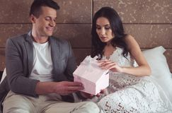 Free Happy Woman Taking Gift From Fiance In First Wedding Night Stock Photo - 119185350