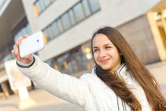 Happy woman taking photo picture. Royalty Free Stock Images