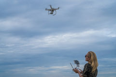 Happy woman taking photos with drone camera Royalty Free Stock Photos
