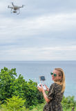 Happy woman taking photos with drone camera Royalty Free Stock Photography