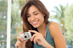 Happy Woman Taking Pictures Stock Image