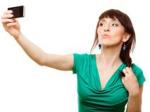 Happy woman taking self picture with smartphone Stock Photo