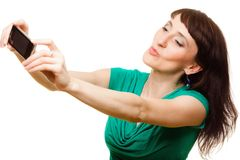 Happy woman taking self picture with smartphone Stock Images