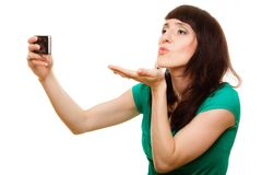 Happy woman taking self picture with smartphone Royalty Free Stock Photo