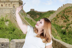 Happy woman taking selfie at great wall. Portrait of happy woman taking selfie picture at great wall of china Royalty Free Stock Photos