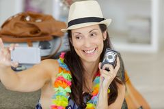 Happy woman taking selfie at home stock photo