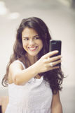 Happy woman taking a selfie with mobile phone Royalty Free Stock Images