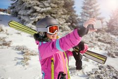Happy woman taking selfie on winter mountain Stock Photography