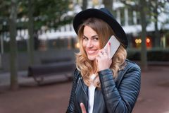 Happy woman talk on mobile phone in paris, france. Sensual woman with long blond hair, hairstyle, beauty. Modern life, new technol. Ogy, mobile device. Fashion Stock Photos